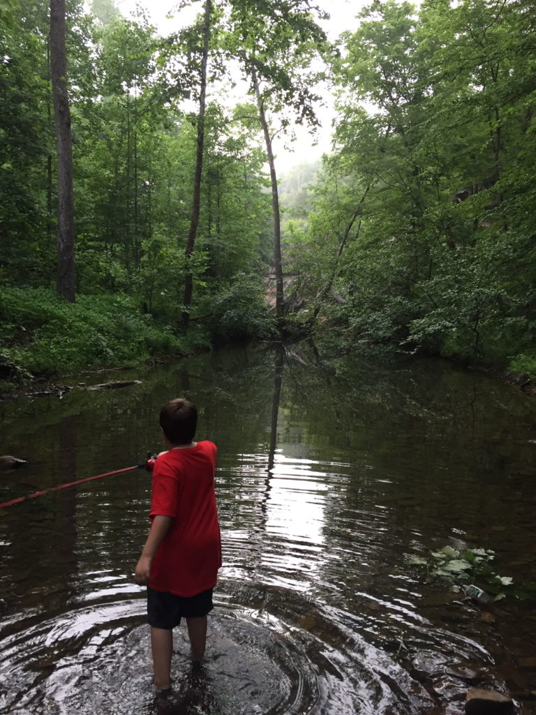 Scout fishing in creek. Parenting through the scout laws.